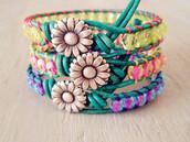 jewels,bracelets,flowers,sun,pink,yellow,purple,grass