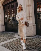 sweater,knitted sweater,oversized sweater,ankle boots,white boots,midi skirt,silk,shoulder bag,sunglasses,earrings