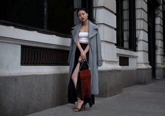 la vagabond dame blogger fringed bag slit skirt slit maxi skirt bustier crop top grey coat long coat wool coat fall outfits front slit skirt grey long coat
