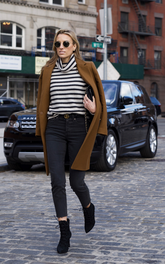 mindbodyswag blogger sweater coat jeans shoes sunglasses belt bag camel coat winter outfits turtleneck sweater gucci striped turtleneck sweater black jeans cropped jeans logo belt
