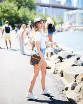top,white top,sneakers,denim shorts,short shorts,hat,bag