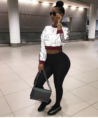 top glasses bun melanin bernice burgos curvy body black girls killin it leggings pants black watch yeezy chanel chanel bag bag purse style adidas supercolor cropped sweater