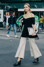 queen of jet lags,blogger,bag,off the shoulder,black top,clutch,white pants,wide-leg pants,office outfits,black heels,pants,black off shoulder top,off the shoulder top,long top,culottes,white clutch,earrings,statement earrings,jewels,mid heel pumps,black shoes,streetstyle