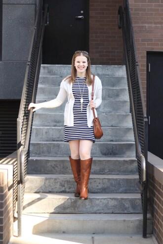 somethinggood blogger t-shirt dress cardigan shoes bag jewels brown boots shoulder bag knee high boots striped dress spring outfits