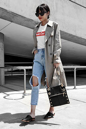 shoes,white graphic t-shirt,grey trench coat,distressed denim jeans,black mules,blogger,studded black bag,sunglasses