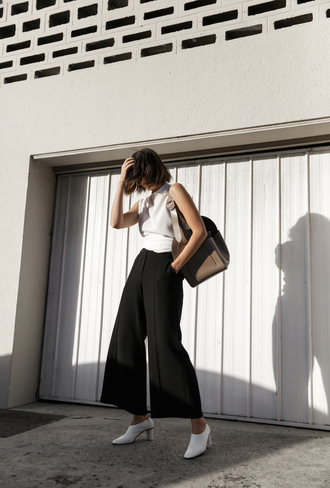 modern legacy blogger pants top bag shoes white top shoulder bag white shoes black pants spring outfits wide-leg pants tumblr high heels sleeveless sleeveless top black and white
