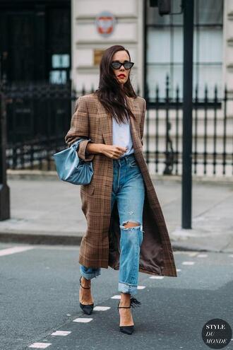 lefashion blogger sunglasses coat jeans brown coat spring outfits blue bag pumps