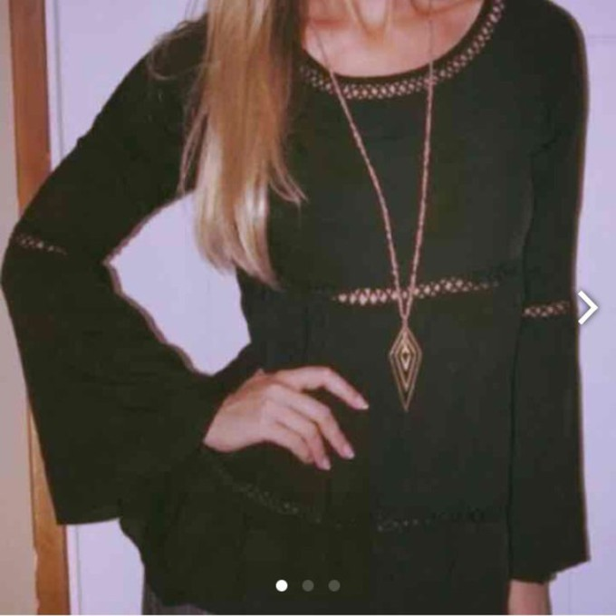 black top shirt blouse long sleeve bell sleeve crochet middle the middle