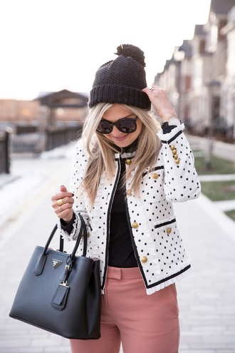 jacket tumblr white jacket polka dots top black top pants pink pants bag black bag designer bag prada bag prada beanie pom pom beanie black beanie sunglasses black sunglasses
