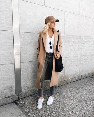hat tumblr cap baseball cap coat camel long coat denim jeans grey jeans sneakers white sneakers top white top bag black bag