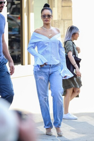 blouse shirt jeans rihanna streetstyle pumps sunglasses off the shoulder shoes ruffle shirt blue shirt striped shirt stripes bun ripped jeans blue jeans boyfriend jeans flats pointed flats necklace jewels jewelry celebrity style celebrity
