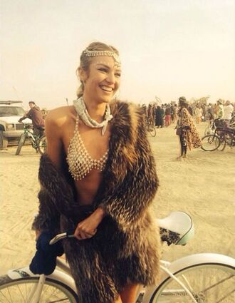 underwear white bra bra burning man burning man clothing hair accessory bandana white bandana coat fur coat brown coat candice swanepoel model celebrity festival music festival jewels jewelry model off-duty accessories accessory head jewels