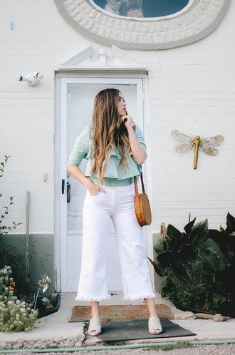 goldenswank blogger top jeans bag jewels mules round bag white pants summer outfits