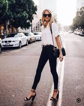 jeans,skinny jeans,black denim,high waisted jeans,white blouse,high heel sandals,shoulder bag,sunglasses