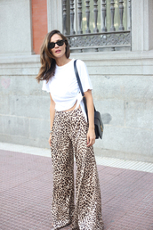 lady addict,blogger,top,pants,bag,t-shirt,tumblr,white top,white crop tops,crop tops,high waisted pants,leopard print,printed pants