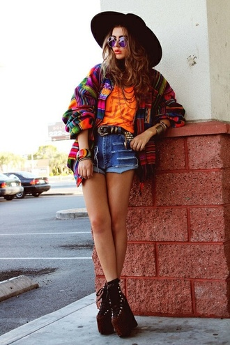 denim shorts soft grunge round sunglasses hippie glasses wavy hair fall outfits fall colors tribal pattern tribal cardigan high waisted shorts grunge shoes platform shoes cuff bracelet cute outfits outfit outfit idea orange black hat