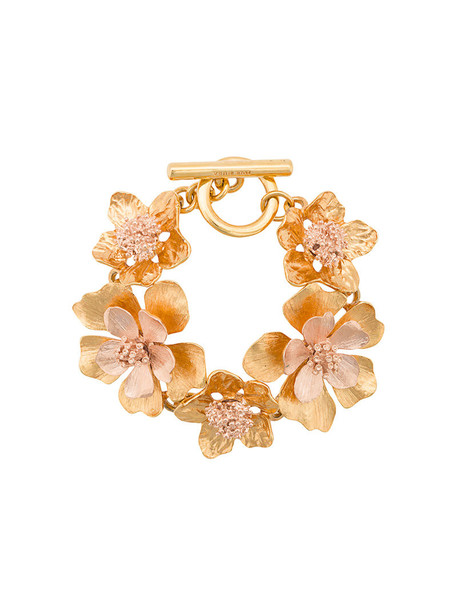 women yellow orange jewels