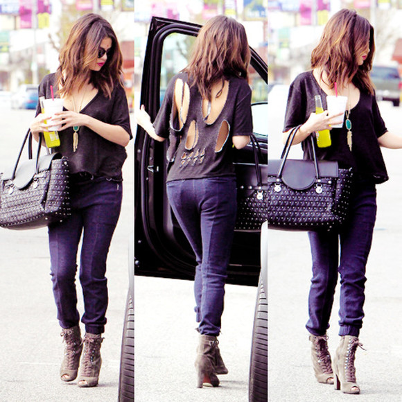 skull shirt sweater skull t-shirt skull sweater shoes pants selena gomez outfit dark blue pants dark blue blue blue pants jeans blue jeans dark blue jeans grey