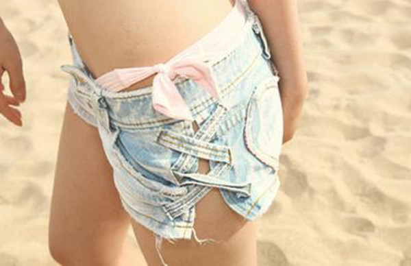 denim blue shorts shorts blue bow stitch denim shorts blue jeans acid wash swimwear ribbon zigzag cut off shorts cut-out lace up slit open sides denim shorts summer cute lovely cut bikini criss cross ripped shorts cross blonde hair orange shirt