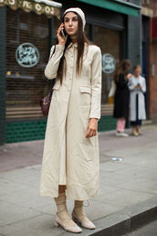 coat,fashion week street style,fashion week 2016,fashion week,nude coat,long coat,beanie,nude beanie,socks and sandals,socks,nude shoes,mid heel pumps,lace up heels,shoes,all nude everything,streetstyle,fall outfits,all beige everything,beige coat