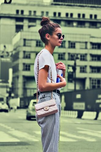 t-shirt taylor hill model off-duty model white t-shirt pants striped pants summer outfits bag white bag chanel chanel bag sunglasses