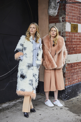 coat nyfw 2017 fashion week 2017 fashion week streetstyle long coat fuzzy coat printed long coat pants peach boots black boots jacket pink jacket fur jacket big fur coat dress peach dress sneakers white skirt girl squad monochrome outfit