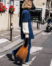 coat,wool coat,pockets,handbag,flats,flare jeans