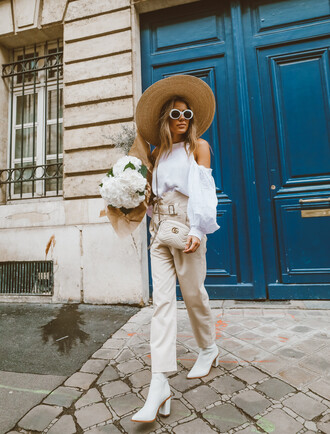 hello fashion blogger sweater pants shoes hat sunglasses jewels cold shoulder top gucci bag beige pants white boots straw hat spring outfits