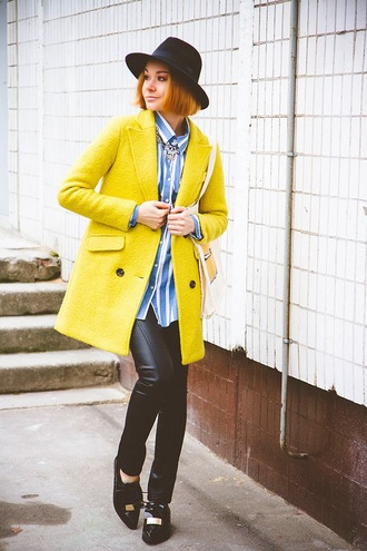 gvozdishe blogger hat bag yellow coat striped shirt leather pants pointed toe loafers statement necklace