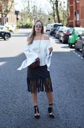 camila carril,blogger,top,skirt,shoes,jewels,sunglasses,bag,off the shoulder,bell sleeves,white top,fringe skirt,burgundy,black heels