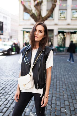jacket white t-shirt leather vest black jeans blogger white bag