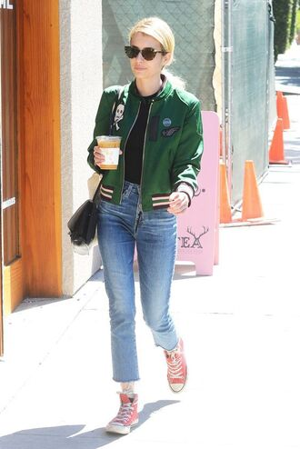 shoes red converse converse red sneakers sneakers high top converse high top sneakers jeans blue jeans cropped jeans cropped bootcut jeans cropped bootcut blue jeans bomber jacket baseball jacket green jacket emma roberts celebrity style celebrity streetstyle bag black bag sunglasses cat eye