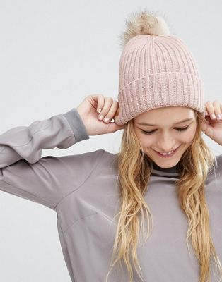 ASOS Rib Beanie With Oversized Natural Faux Fur Pom at asos.com
