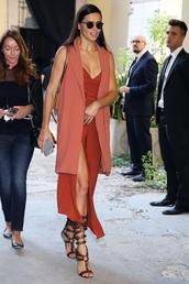 jumpsuit,adriana lima,milan fashion week 2016,sandals,vest,model off-duty,slit pants
