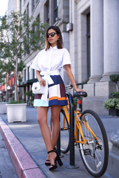 viva luxury,blogger,skirt,white shirt,colorblock,black sandals,white bag,spring outfits,shirt,block heel sandals,black block heel sandals,block heels,white tie front shirt,tie front shirt,black sunglasses,mini skirt,multicolor skirt,white crossbody bag,tie front