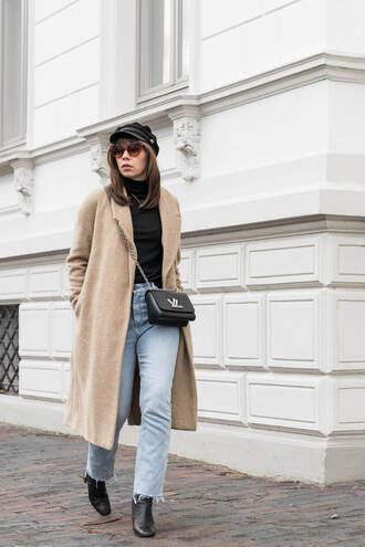 coat hat tumblr camel camel coat top black top turtleneck black turtleneck top fisherman cap jeans denim blue jeans boots bag