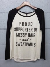 shirt,quote on it,black and white,messy hair,sweatpants,casual shirt,relaxed,proud supporter
