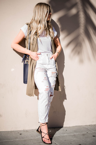 devon rachel blogger t-shirt jacket bag shoes white top sleeveless ripped jeans high waisted jeans lace up lace up heels duster vest nude vest vest white t-shirt white ripped jeans white jeans black bag sandals flat sandals lace up sandals spring outfits