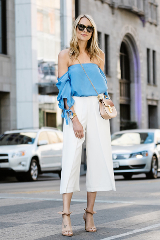 fashionjackson blogger top pants shoes bag sunglasses jewels strapless blue top crossbody bag white pants sandals high heel sandals