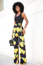blogger,bag,black top,floral,wide-leg pants,black pants,yellow,black bag,mini bag,black girls killin it