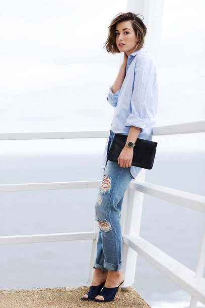 the chronicles of her blogger blue shirt ripped jeans pouch black pouch asymmetric shirt blue jeans cuffed jeans mules shoes ripped jeans black purse black mules