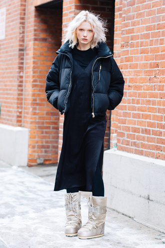jacket tumblr nyfw 2017 fashion week 2017 fashion week streetstyle puffer jacket black jacket dress black midi dress midi dress black dress tights opaque tights boots winter outfits winter boots winter look top black top slit dress black slip dress white boots blogger black puffer jacket