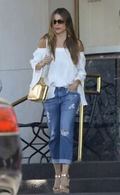 top,sofia vergara,sandal heels,bag,sunglasses,earrings,denim,jeans,summer outfits,off the shoulder,white top,ripped jeans,cuffed jeans