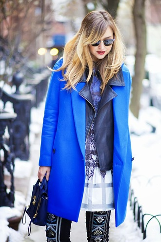 dress shoes jeans jewels jacket bag sunglasses coat late afternoon