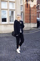 into the fold,blogger,baseball jacket,black pants,pants,bag,jacket,top,sunglasses,striped top