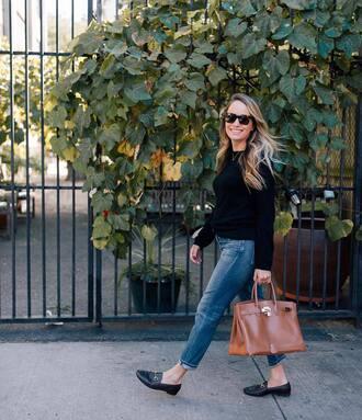 sweater black sweater pants blue pants shoes black shoes