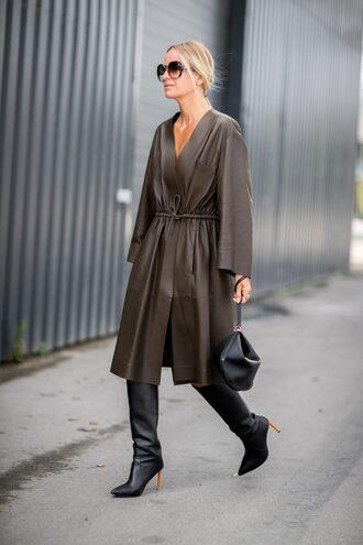 coat leather coat copenhagen fashion week streetstyle khaki boots black boots high heels bag handbag sunglasses fall outfits