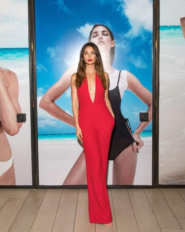 jumpsuit red plunge v neck plunge neckline lily aldridge model off-duty top pants
