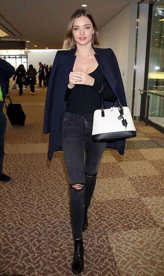 miranda kerr model off-duty jeans blue jacket blazer blue coat white bag black top black jeans ripped jeans black boots