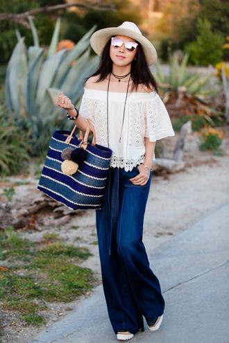 off the shoulder blue bag wide-leg pants high waisted jeans white top jeans bag hat sunglasses jewels